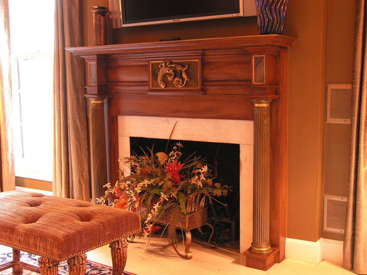 Faux wood fireplace with metallic gold leaf