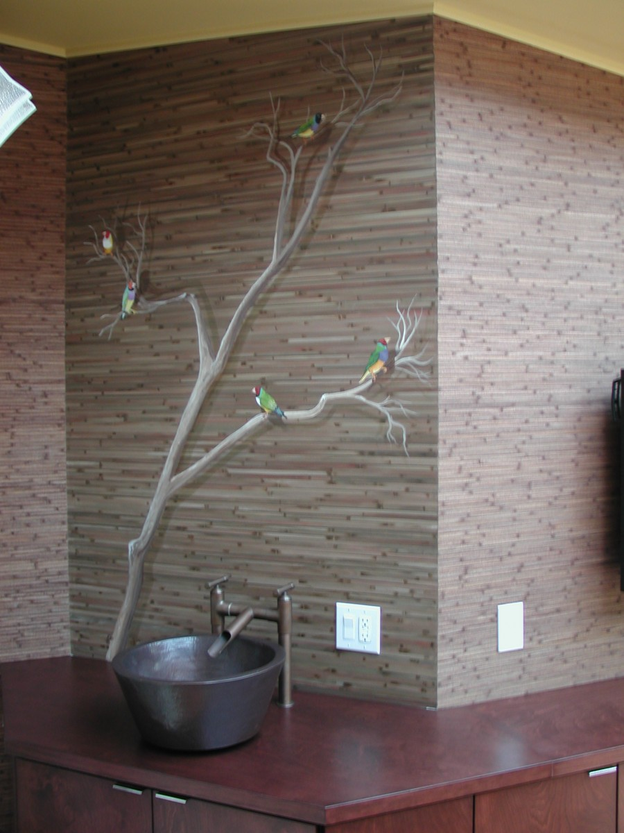 Mural of Finches on tree with reed painted behind (after)