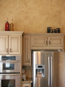 Texture - Venetian Plaster with bronze wax and aged kitchen cabinets