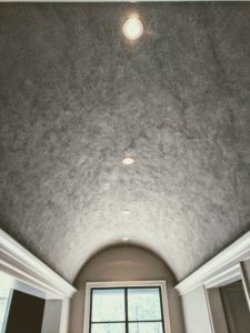 Glass beads on barreled ceiling
